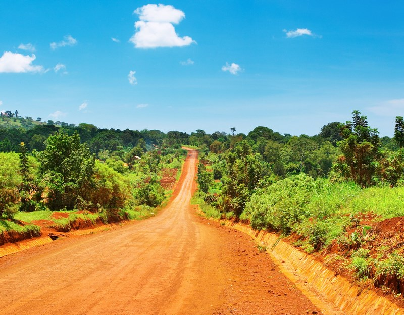 4215153 - african landscape with road and blue sky, uganda